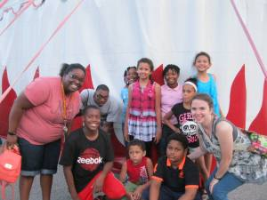 Akeen, Sheree, Candace, and various children, posing after a visit to Circus Flora